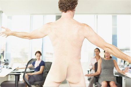 Naked businessman in office Stock Photo - Premium Royalty-Free, Code: 635-02614469
