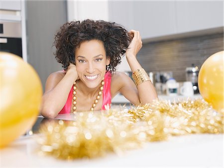 Woman in kitchen with Christmas party decorations Stock Photo - Premium Royalty-Free, Code: 635-02614676