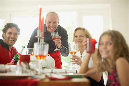 Family enjoying Christmas dinner Stock Photo - Premium Royalty-Free, Code: 635-02614688