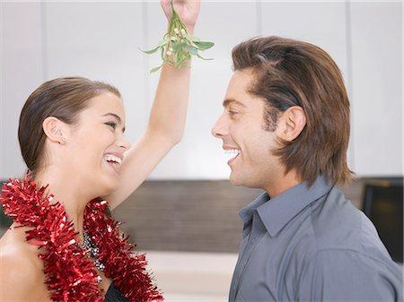 Couple kissing under mistletoe Stock Photo - Premium Royalty-Free, Code: 635-02614692