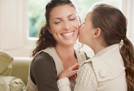 Daughter kissing mother Stock Photo - Premium Royalty-Free, Code: 635-02614789