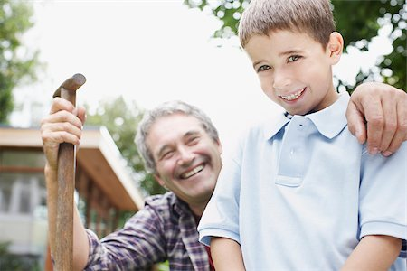 Grandfather and grandson gardening Stock Photo - Premium Royalty-Free, Code: 635-02614839