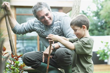 Grandfather and grandson gardening Stock Photo - Premium Royalty-Free, Code: 635-02614843