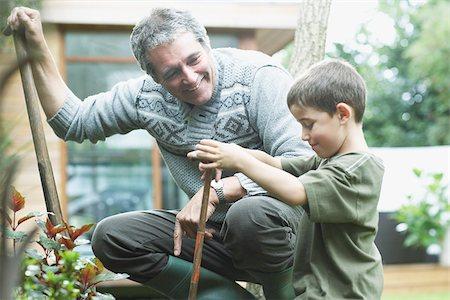 Grandfather and grandson gardening Stock Photo - Premium Royalty-Free, Code: 635-02614843