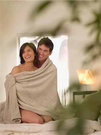 Boyfriend hugging girlfriend in bed Stock Photo - Premium Royalty-Free, Code: 635-02799911