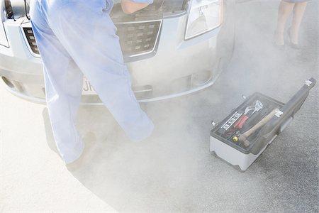 stalled car - Mechanic checking smoking car engine Stock Photo - Premium Royalty-Free, Code: 635-02799969
