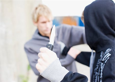 enemy - Attacker with knife threatening man Stock Photo - Premium Royalty-Free, Code: 635-02800008