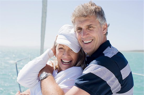 Mature couple hugging on boat Stock Photo - Premium Royalty-Free, Image code: 635-02800265