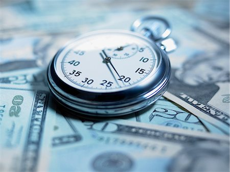 stop watch - Close up of stopwatch on 20 dollar bills Stock Photo - Premium Royalty-Free, Code: 635-02800348