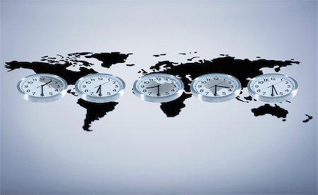 Time zone clocks on world map Stock Photo - Premium Royalty-Free, Code: 635-02800476