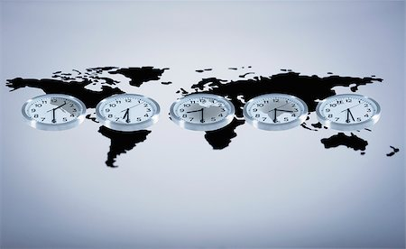 Time zone clocks on world map Stock Photo - Premium Royalty-Free, Code: 635-02800476
