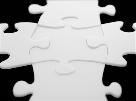 Interlocking puzzle pieces Stock Photo - Premium Royalty-Free, Code: 635-02800477