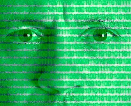 Montage of man's face with binary code Stock Photo - Premium Royalty-Free, Code: 635-02800554