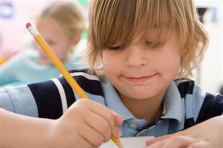 Boy doing school work Stock Photo - Premium Royalty-Free, Code: 635-02800708