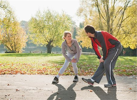 Couple stretching in park in autumn Stock Photo - Premium Royalty-Free, Code: 635-02942666