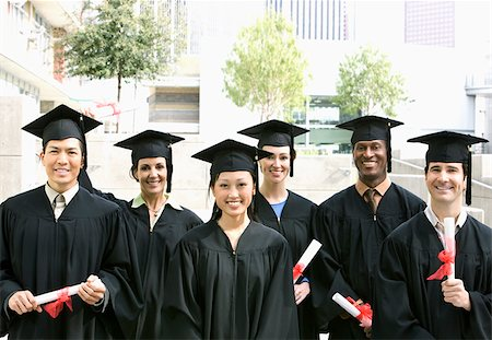 Graduates in caps and gowns with diplomas Stock Photo - Premium Royalty-Free, Code: 635-02942932
