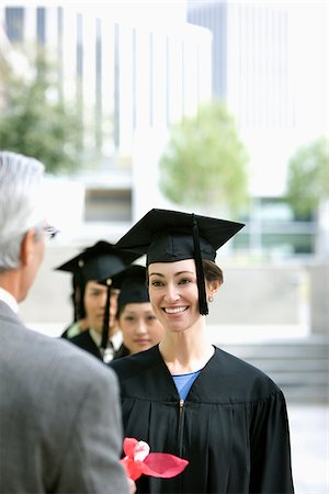 Dean presenting graduates with diplomas Stock Photo - Premium Royalty-Free, Code: 635-02942995