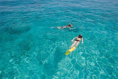 Girls snorkeling in ocean Stock Photo - Premium Royalty-Free, Code: 635-02943164