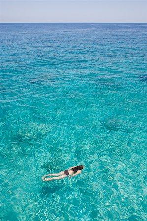 Girl swimming in ocean Stock Photo - Premium Royalty-Free, Code: 635-02943169