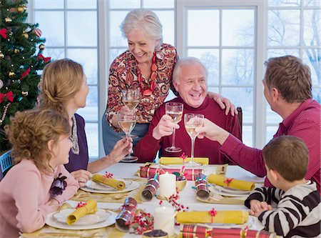 Multi-generation family toasting at Christmas dinner Stock Photo - Premium Royalty-Free, Code: 635-02990240