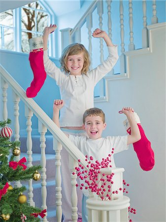 pantyhose kid - Boy and girl holding Christmas stockings on stairs Stock Photo - Premium Royalty-Free, Code: 635-02990264