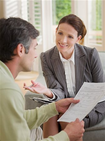 Businesswoman discussing paperwork with man Stock Photo - Premium Royalty-Free, Code: 635-02990358