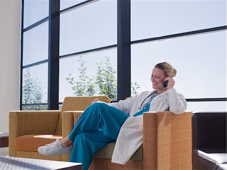 doctor in waiting room - Doctor talking on cell phone in hospital waiting area Stock Photo - Premium Royalty-Free, Code: 635-03161514