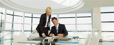Business people working in modern office Stock Photo - Premium Royalty-Free, Code: 635-03161578