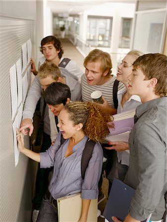 results - College students checking test scores in corridor Stock Photo - Premium Royalty-Free, Code: 635-03228747