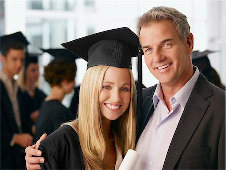 Father and graduate daughter hugging Stock Photo - Premium Royalty-Free, Code: 635-03228762
