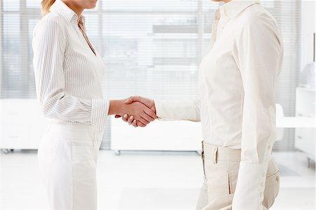 Businesswomen shaking hands Stock Photo - Premium Royalty-Free, Code: 635-03229180