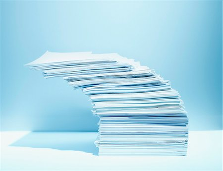 Stack of paper piled precariously Stock Photo - Premium Royalty-Free, Code: 635-03372919