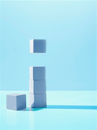 results - Block hovering over stack of blocks Stock Photo - Premium Royalty-Free, Code: 635-03372927