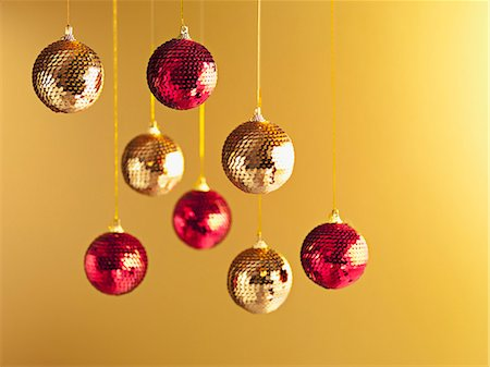 Christmas ornaments hanging from string Stock Photo - Premium Royalty-Free, Code: 635-03372985