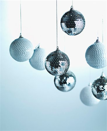 Christmas ornaments hanging from string Stock Photo - Premium Royalty-Free, Code: 635-03372986