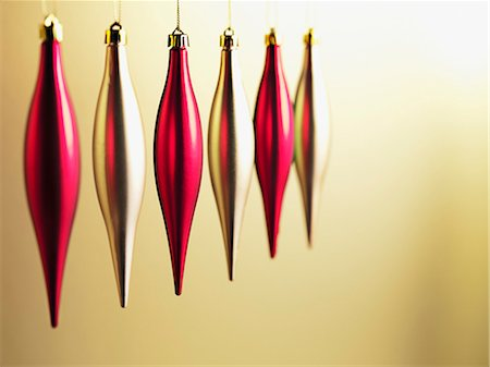 Christmas ornaments hanging in a row Stock Photo - Premium Royalty-Free, Code: 635-03372993