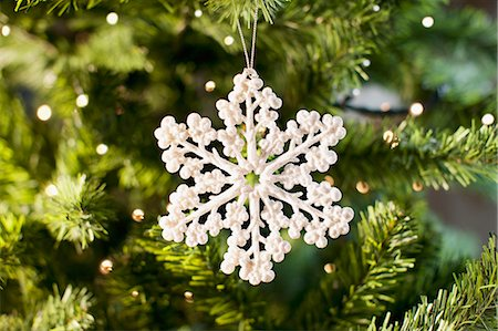 Snowflake Christmas ornament on tree Stock Photo - Premium Royalty-Free, Code: 635-03373022