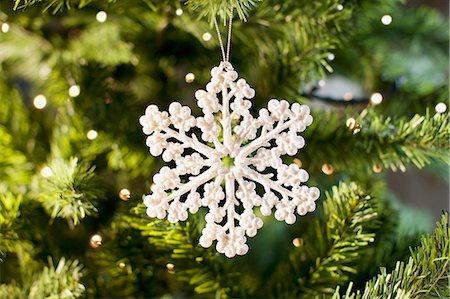 Snowflake Christmas ornament on tree Stock Photo - Premium Royalty-Free, Code: 635-03373022