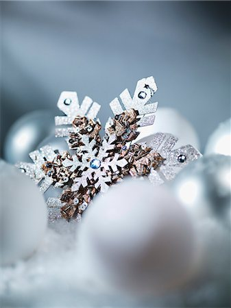 snowflakes  holiday - Close up of snowflake Christmas ornament Stock Photo - Premium Royalty-Free, Code: 635-03373047