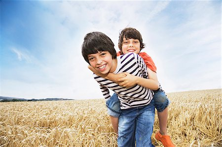 riding crop - Boys playing in wheat field Stock Photo - Premium Royalty-Free, Code: 635-03373137