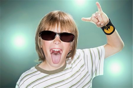 preteen open mouth - Boy with sunglasses making horn gesture Stock Photo - Premium Royalty-Free, Code: 635-03373306
