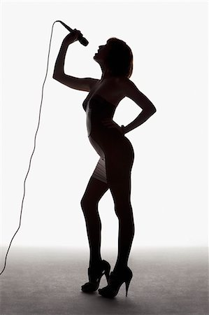 Silhouette of woman singing Stock Photo - Premium Royalty-Free, Code: 635-03373312