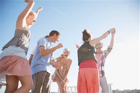five people - Friends dancing on rooftop Stock Photo - Premium Royalty-Free, Code: 635-03441023