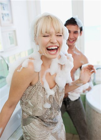 Couple covered with soap suds in bathroom Stock Photo - Premium Royalty-Free, Code: 635-03441074