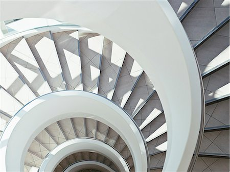 spiral - Directly above modern, spiral staircase Stock Photo - Premium Royalty-Free, Code: 635-03441153