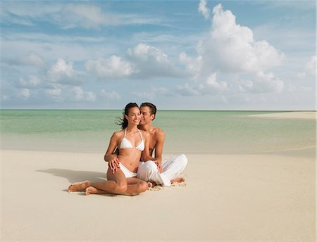 Couple sitting on beach Stock Photo - Premium Royalty-Free, Code: 635-03441315