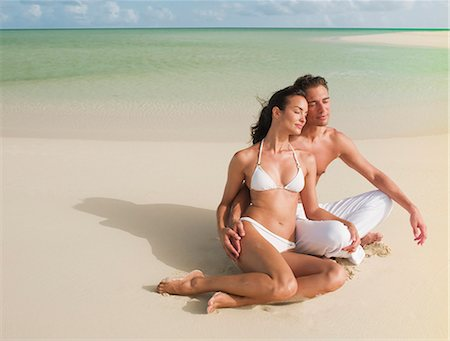 Couple sitting with eyes closed on beach Stock Photo - Premium Royalty-Free, Code: 635-03441316
