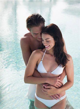 Couple hugging in swimming pool Stock Photo - Premium Royalty-Free, Code: 635-03441324