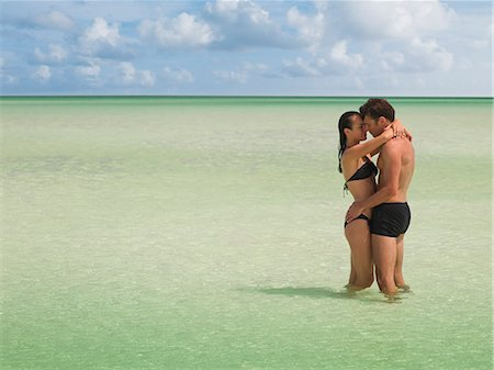 Couple hugging in ocean Stock Photo - Premium Royalty-Free, Code: 635-03441335