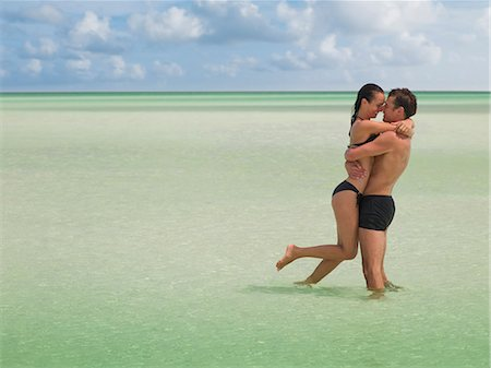 Couple hugging in ocean Stock Photo - Premium Royalty-Free, Code: 635-03441338